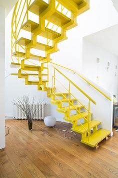 An easy way to add some drama to your home is with colour. Yellow is the happiest colour of all so why not paint your kitchen chairs/stairs/buffet yellow, or tile your bathroom yellow, or have your entire staircase fabricated in yellow.