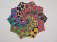"wow! from the maker: ""This is a paper pieced pattern from Quilts with style magazine Sept/Oct 2006. This is a rather difficult pattern. It is hard to keep track of coloring."""