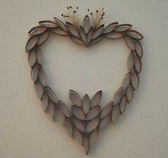 This pretty heart is made from recycled toilet paper tubes! Full directions at HappySimpleLiving.com.