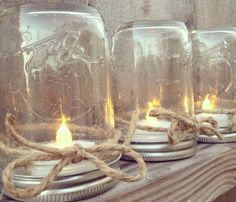 Mason Jar Table Lanterns: Upside down Mason Jars with tea lights inside Led Tealight Candles, Tea Light Candles, Tea Lights, Candle Centerpieces, Battery Candles, Centerpiece Ideas, Centerpiece Flowers, Canning Jar Centerpieces, Outdoor Table Centerpieces