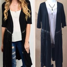 Beautiful Cardigan Pretty half sleeve black cardigan with fringe around middle.  Very versatile. Sweaters Cardigans