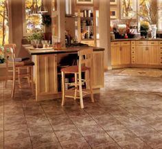 Keep your kitchen up-to-date starting with your floor. Use this guide to the hottest 2018 kitchen flooring trends and find durable, stylish kitchen flooring ideas that will stay trendy for years to come. Kitchen Floor Tile Patterns, Kitchen Flooring Options, Best Flooring For Kitchen, Wood Floor Kitchen, Kitchen Floors, Kitchen Vinyl, Kitchen Tile, Kitchen Cabinets, Vinyl Flooring Bathroom