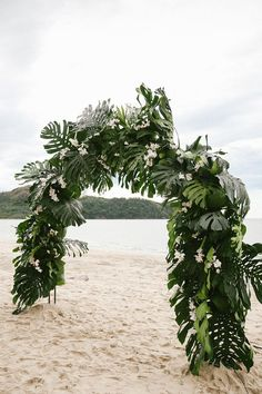 tropical beach wedding in Costa Rica - photo by W and E Photographie http://ruffledblog.com/costa-rica-destination-wedding-with-lots-of-tropical-details