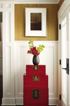 red chests have a great impact... I love this!! And against white with the wall color at the top. Perfect.