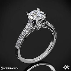 This Diamond Engagement Ring is from the Verragio Couture Collection. It features 0.30ctw of Round Brilliant Diamond Melee (F/G VS) that enhance a round diamond center of your choice. The width tapers from 2.7mm at the top down to 1.8mm at the bottom. Select your diamond from our extensive online diamond inventory. Please allow 4 weeks for completion. Platinum rings carry a 5 week turnaround time. If you have any questions regarding this item then please contact one of our friendly diamond…