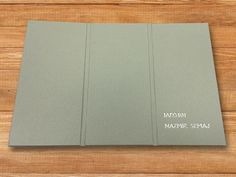 (Image 3 of 3): Interscrew binder, which can be opened by the customer any time to add/remove sheets. The customer wanted the cover to fold several times to create a look and feel similar to an iPad case. This bespoke bookbinding was produced by The Document Centre, South London (www.document-centre.co.uk).