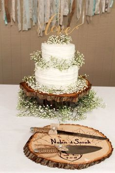 rustic buttercream wedding cake with tree stump and baby breath / http://www.deerpearlflowers.com/rustic-budget-friendly-gypsophila-babys-breath-wedding-ideas/