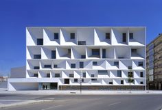 Mansilla + Tuñón - León Auditorium in Leon, Spain. 2002. The façade consists of a grid of recessed bays, arranged in 5 horizontal bands in reference to a musical score.