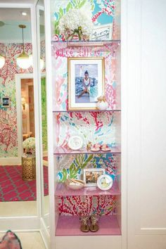 Wonderful shelving unit at the Lilly Pulitzer store!  Wallpaper a print behind in back of the unit and install clear shelves.