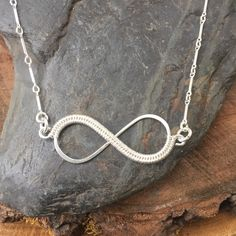 A personal favorite from my Etsy shop https://www.etsy.com/listing/488117167/wire-wrapped-necklace-infinity-necklace