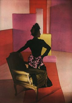 Dinner suit of satin and crepe - the suit Schiaparelli wore with great success on a recent trip to New York - is, in itself, a sort of summary of her designing tradition.  (Harpers Bazaar, February, 1947)