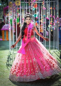 Mehendi Outfits - Twirling Bride in a Pink and Red Lehenga | WedMeGood | Pink Net Lehenga with Silver and Red 3-D Flowers and a Red Choli  #wedmegood #indianbride #indianwedding #pink #lehenga #twirling #mehendioutfit #saganoutfit