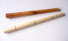 magic wands in turned yew, sycamore+ acrylic colours. Line sequence is the Fibonacci series.