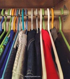 Tips for an organized closet: All our clothes get hung backwards in the closet; as we wear each item, we put them back in the regular hanging position. This gives us a quick visual of what we wear | MOSTLYORGANIZED.COM