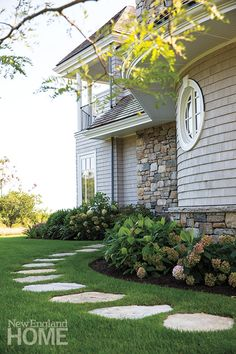 A granite stepping-stone path with a simple perennial border leads to a side entrance. Stepping Stone Pathway, Stone Paths, Flagstone Pathway, Landscape Design, Garden Design, New England Homes, House And Home Magazine, Shade Garden, Pathways