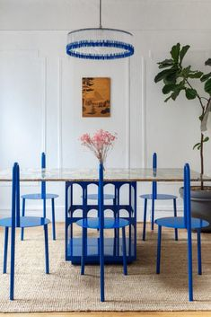 Harry Nuriev's apartment in Brooklyn is a mix between a familiar universe, and the designer's famous furniture and colours | Harry Nuriev | Crosby Studios | Brooklyn apartment | american apartment | american design | american designer | blue chair | electric blue chairs | dining room | 2018 interior design trends | american interior design | marble table | Brooklyn design studio | new american design wave | 2018 design trends | 2018 color trends | white walls | sculptural design...