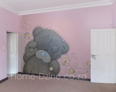 This adorable tatty teddy mural adorns the wall of a special little girl's bedroom. Painting a mural itself is not difficult - it all depends on the design you choose. Tatty teddy took 4 days to complete, but the result what oh so worth it.