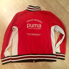 Puma track jacket Red and cream track jacket from Puma. There is a small stain on the back of the right arm, hardly noticeable. A little bit of pulling under the arms and on the bottom by the pockets. Puma Jackets & Coats