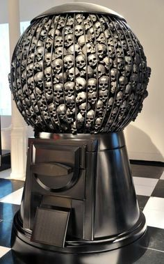 A giant silver gumball machine filled with silver skulls. Mushroom cloud after an atomic bomb, but this one looks like a clown. are we going a little Stephen King here …
