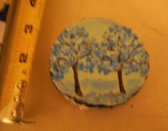 "Small wooden ornament. painted on a wood, size about 3""."