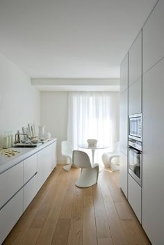 white on white kitchen with wood floors