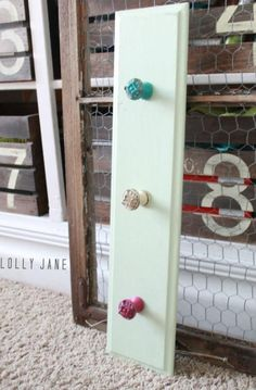 {DIY Coat Rack with Colored Knobs!}