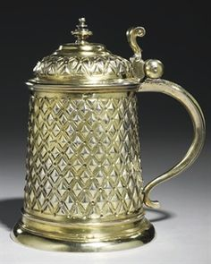 CHOPE EN VERMEIL. A GERMAN SILVER-GILT TANKARD MAKER'S MARK OF PHILIPP PEPFENHAUSER, AUGSBURG, CIRCA 1612 Tapering cylindrical on spreading foot, the body and cover with hob-nail ornament divided by matting and circles, with baluster finial, bifurcated thumbpiece and scroll handle. COLLECTION YVES SAINT LAURENT ET PIERRE BERGÉ.