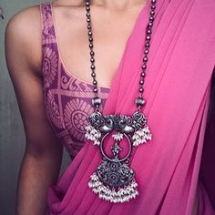 Pink saree with purple gold blouse and oxidized silver necklace Trendy Sarees, Stylish Sarees, Simple Sarees, Saree Blouse Patterns, Saree Blouse Designs, Henna Patterns, Dress Patterns, Saree Styles, Blouse Styles