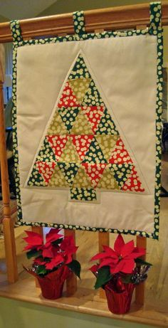 Sew a bunch of triangles together to make a big triangle, add a trunk, and you have a tree.