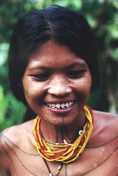 Teeth sharpening - one of the mentawai traditions. Siberut island. Sumatra, Indonesia.