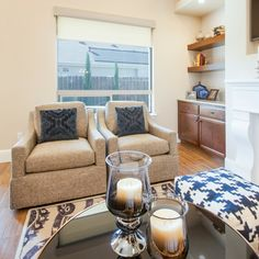 Transitional Living Room, custom comfortable swivel chairs are the perfect place to relax.