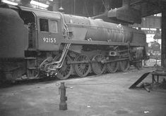 British Railways Standard Class 9F 2-10-0 No 92155 stands 'cold and serviced' around No 3 shed's turntable