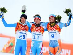 Silver medalist Christof Innerhofer (L) of Italy, gold medalist Matthias Mayer (C) of Austria and bronze medalist Kjetil Jansrud (R) of Norway stand on the podium during the flower ceremony for the Alpine Skiing Men's Downhill at Rosa Khutor Alpine Center | Sochi 2014 Winter Olympics