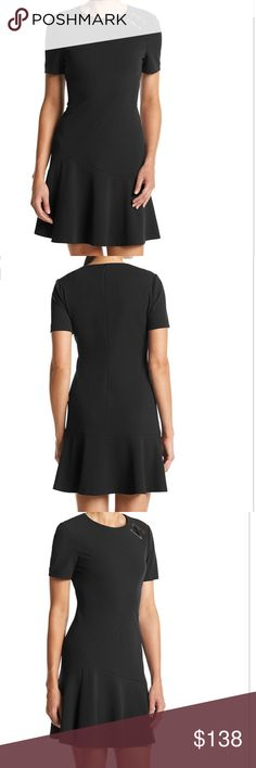 COMING SOON - Ivanka Trump Crepe Scuba Shirt Dress Create a sleek style with this scuba knit dress from Ivanka Trump that features a hardware accent at the shoulder and a flared skirt. Featured in black Crew neck Short sleeves Hardware accent Seamed, flared skirt Polyester Imported Ivanka Trump Dresses