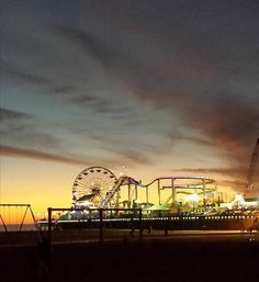 After an afternoon on a private Los Angeles tour our Elite Adventure Tour guests pause to watch the sun set beyond the Santa Monica Pier on a warm winter day in southern California.