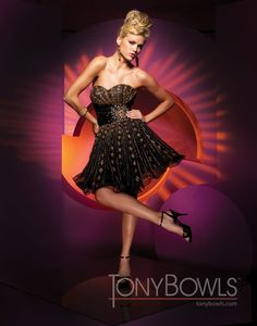Strapless sweetheart organza knee-length A-line dress with diamond-shaped hand-beading, pleated cummerbund with crystal star-burst accent, full skirt. Detachable straps included.