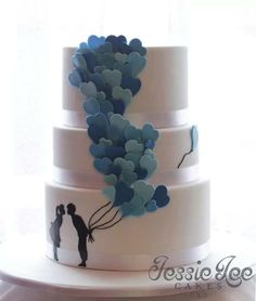 Jessie Lee Cakes.  Balloon heart wedding cake. The bottom tier has blue ombre cake on the inside :)