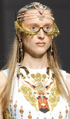 A model at Paris fashion week with hair accessories and Heart of Gold earrings from the Manish Arora Amrapali collection.