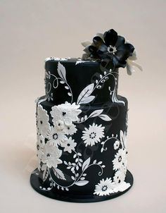 Black cake with white flowers & topper