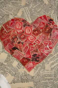 ReFab Diaries: Repurpose: Playful Postage ... Love the mix of red postage stamps with old book page!! Perfect for a Valentine's frame