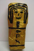 Make a mummy case for doll @ http://www.activityvillage.co.uk/mummy-case-for-fashion-doll. MUMMIFY A DOLL FOR YOUR CASE @ http://www.activityvillage.co.uk/mummified-fashion-doll