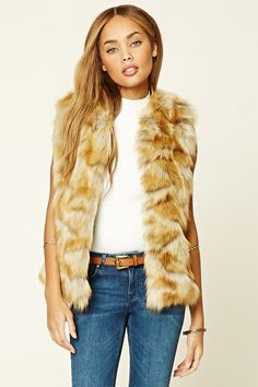 A super-soft faux fur vest with a single hook-eye closure at the neckline.