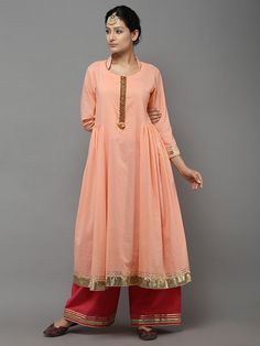 Description: Cotton kurta with ghungroo and gota panel in front It has Gathers on the sides at waist Kurta has Intricate gota piping and detailing on sleeves an