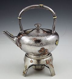 Dominick and Haff sterling hammered mixed metals kettle on stand circa 1880