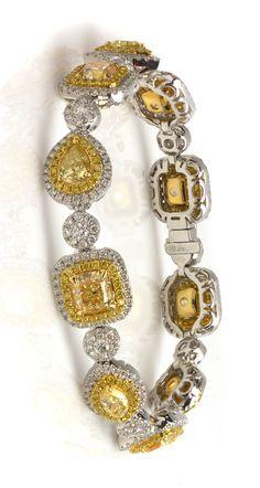 Exquisite Yellow Diamond & White Diamond Bracelet! Accessorize with brilliant jewelry. Item #366-70005717 11.50 ctw Yellow Diamond Multi-shape & 4.55 ctw White & Yellow Diamond Round 18K 2 Tone Gold Bracelet W/ Appraisal Length 7.25 - Gem Shopping Network