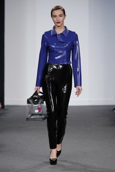 Navy / royal blue latex coat with 6 buttons and collar.  Paired with black latex pants with side zip.  Outfit designed via collaboration between Lelo and Madrub.. Buy the supplies to make this: http://mjtrends.com/pins.php?name=navy-and-black-latex-for-outfits