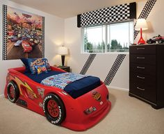 A checkered flag valance and whimsical tire tracks on the wall complete this clever race car theme. Residence 3. New homes by Polygon Northwest. Maple Valley, WA.