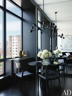 The dining area of Gilles Mendel's Manhattan apartment is black throughout—from a black-lacquer chandelier right down to the floors | archdigest.com