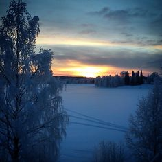 Sunset over a frozen river Rovaniemi