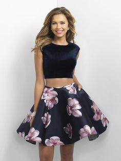 Blush 11179 is a two piece short homecoming dress with a Velvet cap sleeve top with a deep scoop back and a floral print Mikado skirt.